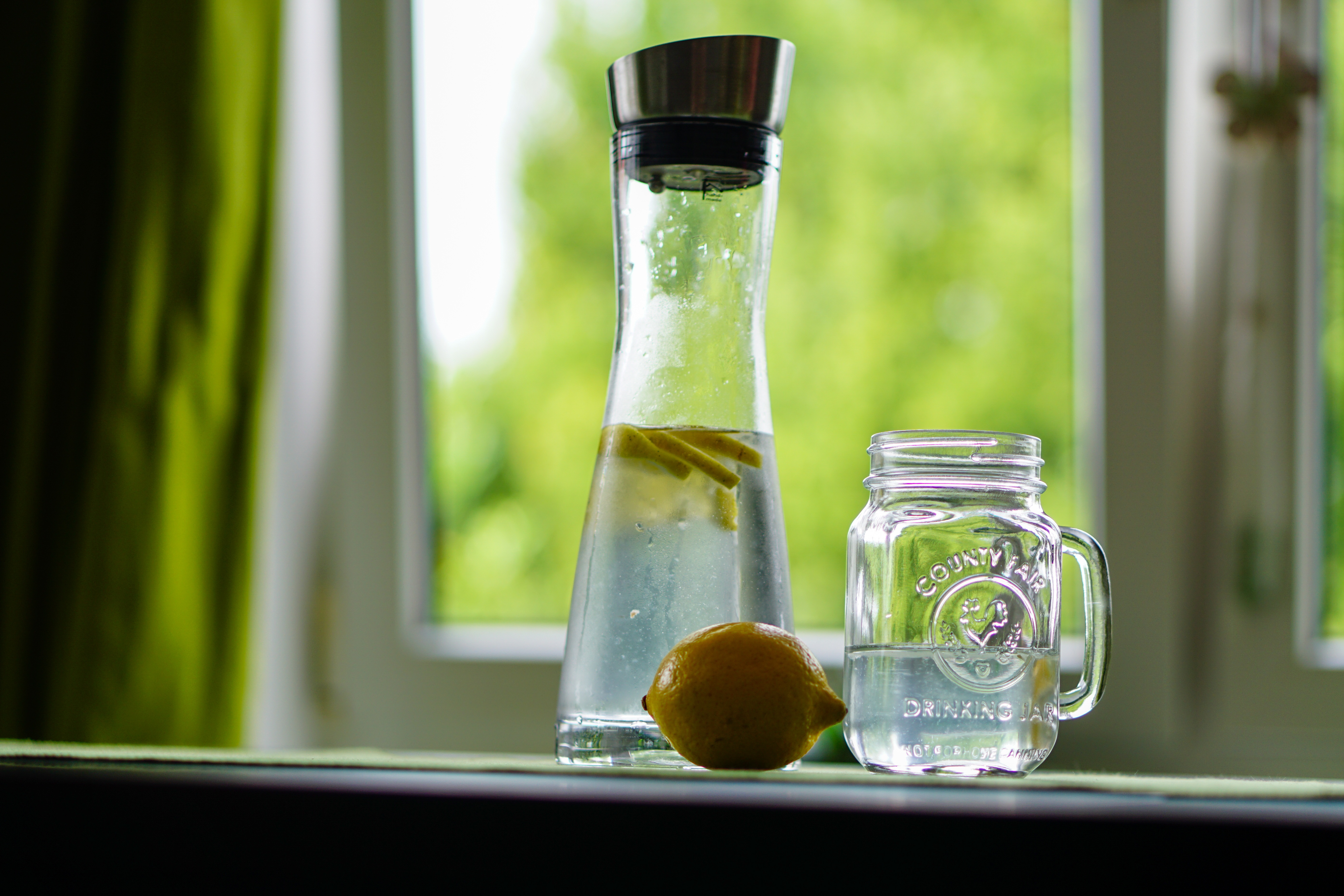 Canva - Shallow Focus Photography of Yellow Lemon Near Glass Mason Jar and Glass Decanter